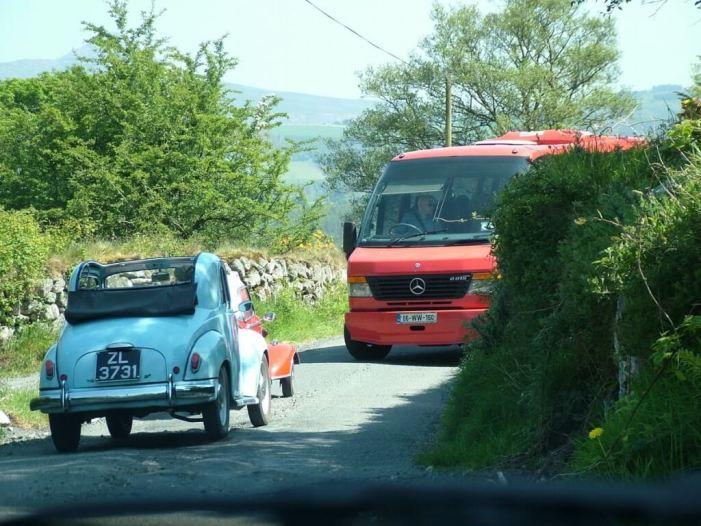 Red Messerschmitt KR- 175 microcar meets bus on tight road - Enniskerry - Wicklow - Ireland