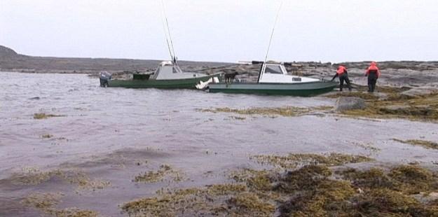boats on shoreline of kekerten island - nunavut