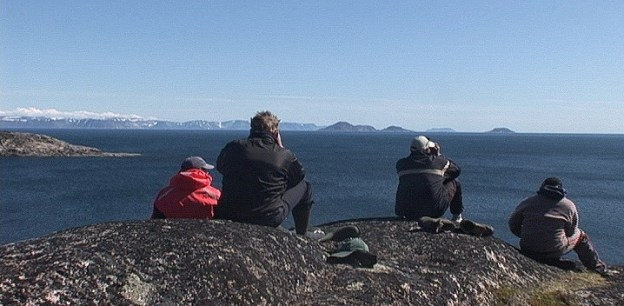 Group searches with binoculars for Bowhead Whales off Kekerten Island in the Cumberland Sound, off Baffin Island, Nunavut, Canada