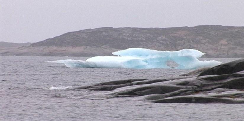 iceberg and baffin island coastline - nunavut