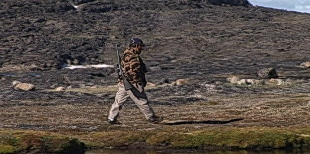 inuit guide with gun leads the way - kekerten island - nunavut - canada