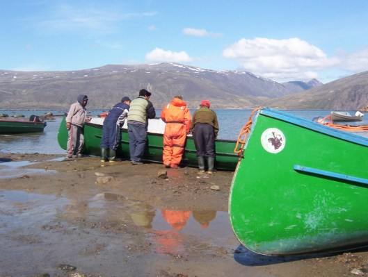 Inuit guides and boats at Pangnirtung on Baffin Island in Nunavut, Canada