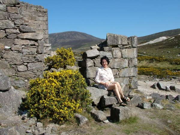 jean sits beside miners village ruins - glendalough - wicklow - ireland