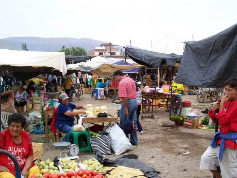 shoppers in street market - nazca - peru
