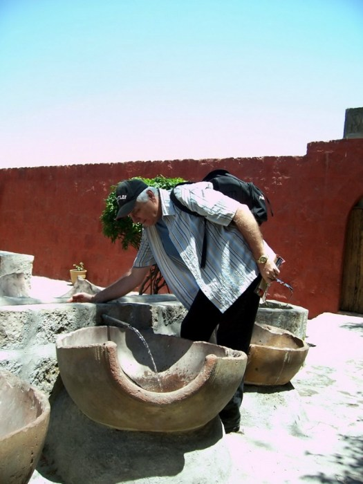 Bob checks out water flow, Santa Catalina Convent, Arequipa, Peru