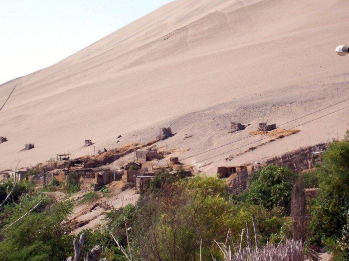 sand dune village near camana - peru