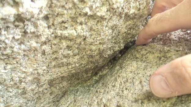 bob checks rock cut in the brownshill dolmen - county carlow - ireland