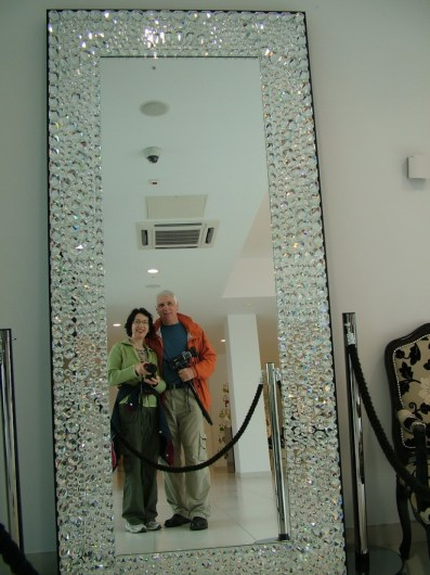 An image of Jean and Bob reflected in a large mirror at House of Waterford Crystal in Waterford, Ireland. Photography by Frame To Frame - Bob and Jean.
