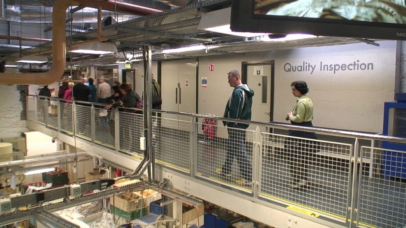 Image of tour group above the quality control room at the Waterford Crystal factory in Waterford, Ireland. Photography by Frame To Frame - Bob and Jean.