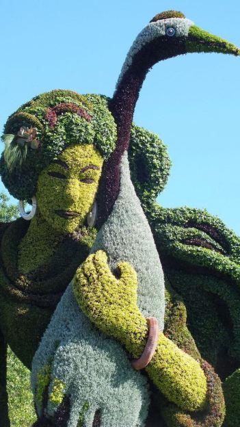 A true story ( woman holds a bird) - Mosaiculture - Montreal Botancial Gardens