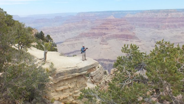 Bob stands on edge of South Rim - Grand Canyon