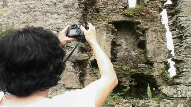 Coppinger's Court ruins, jean takes picture of former fireplace upon wall, county cork, Ireland