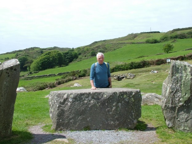 An image of Bob standing beside recumbent axial stone at the Drombeg Stone Circle in County Cork, Ireland.  Photography by Frame To Frame - Bob and Jean.