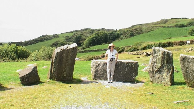 An image of Jean leaning againt the Recumbent axial stone at the Drombeg Stone Circle in County Cork, Ireland.  Photography by Frame To Frame -  Bob and Jean