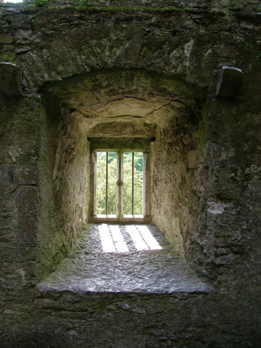 An image of a window in the wall of Blarney Castle near Cork in Ireland. Photography by Frame To Frame - Bob and Jean.