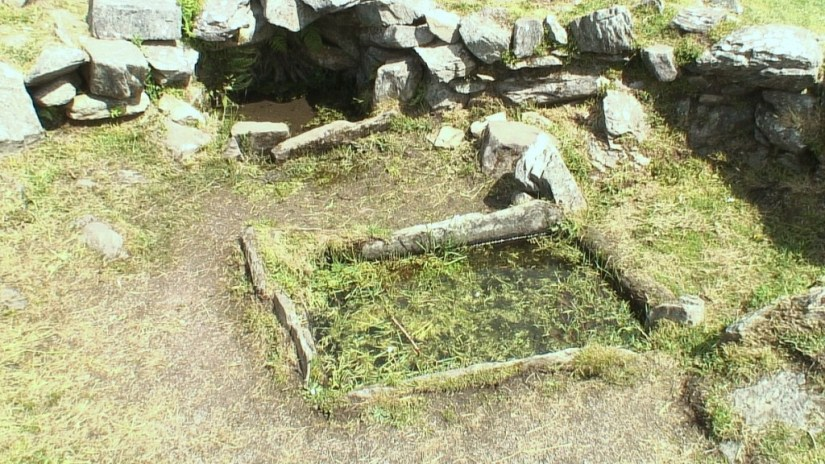 An image of the Fulacht Fiadh cooking site near the Drombeg Stone Circle in County Cork, Ireland. Photography by Frame To Frame - Bob and Jean.