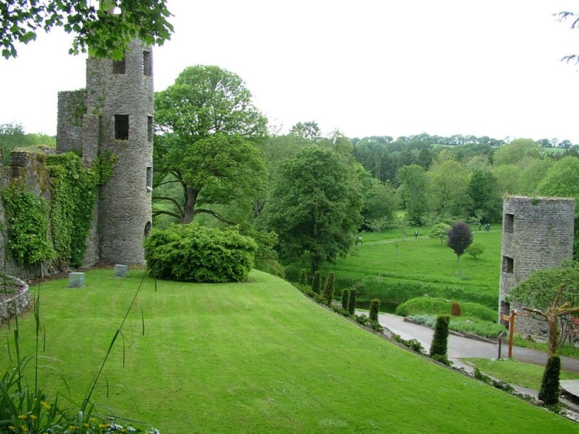 An image of the green lawns and towers beside Blarney Castle, in Ireland. Photography by Frame To Frame - Bob and Jean.