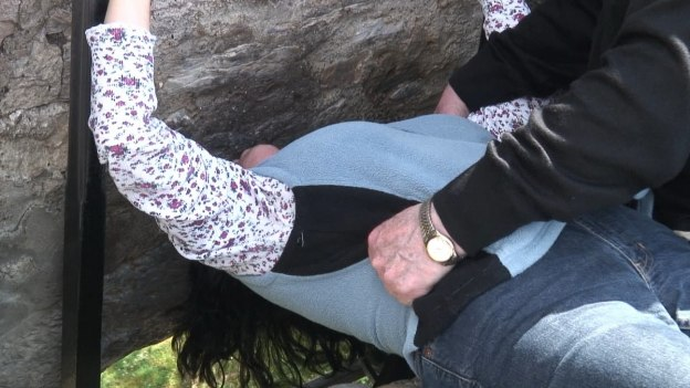An image of Jean kissing the Blarney Stone at Blarney Castle in Ireland.  Photography by Frame To Frame - Bob and Jean.