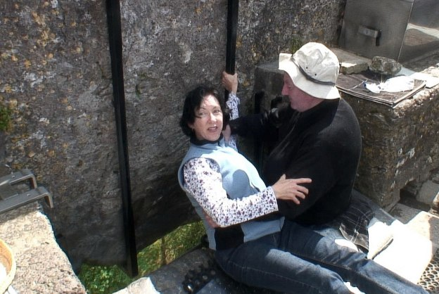 An image of Jean preparing to Kiss the Blarney Stone at Blarney Castle in Ireland.  Photography by Frame To Frame - Bob and Jean.
