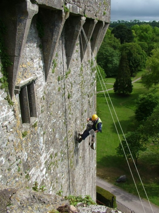 stone mason restores blarney castle, county cork, ireland
