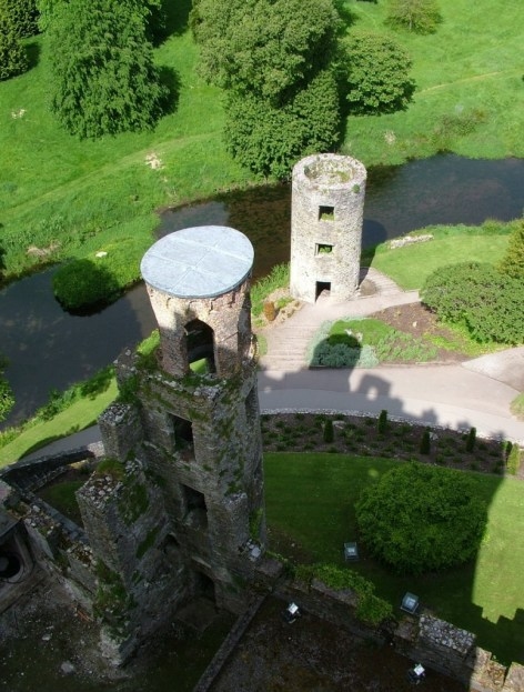 view of stone towers below at blarney castle, ireland