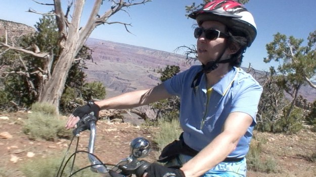 Jean riding a bike along the South Rim at Hermit's Rest at Grand Canyon National Park in Arizona, U.S.A.