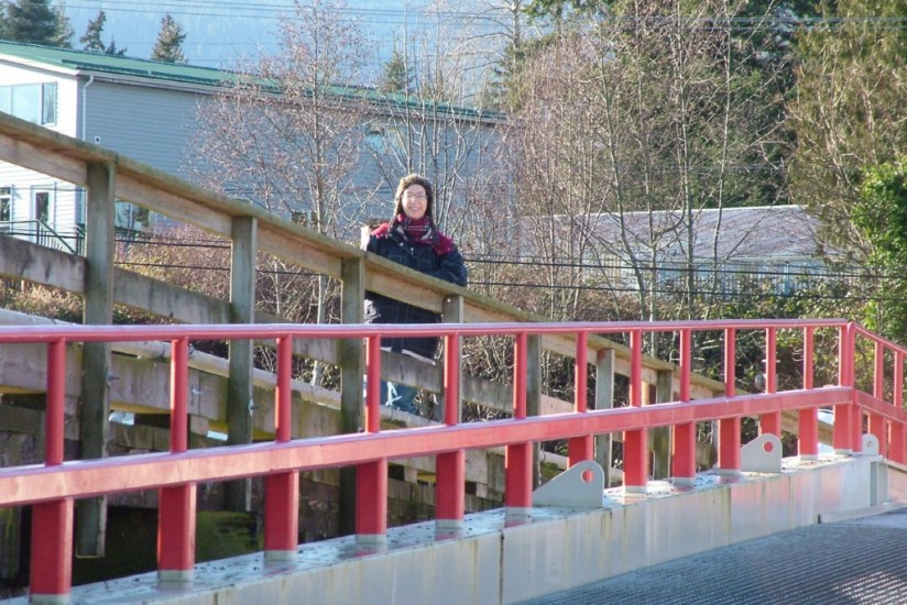 Jean standing on the launching ramp at Fanny Bay on Vancouver Island in B.C., Canada