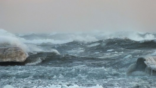 big waves break over breakwater - lake ontario - toronto - jan 24 2014