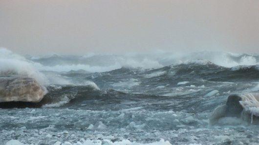 big waves break over breakwater - lake ontario - toronto - jan 24 2014