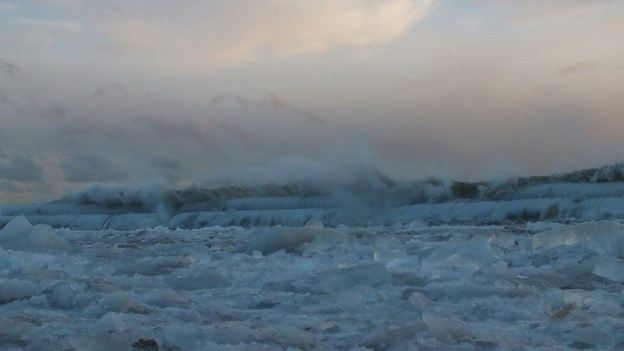 Icy waves breaking at Sunnyside on Lake Ontario in Toronto, Ontario, Canada
