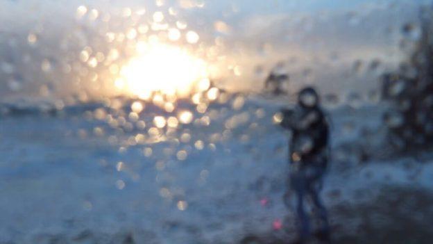 Camera lens covered in misty rain at Sunnyside on Lake Ontario in Toronto, Ontario, Canada