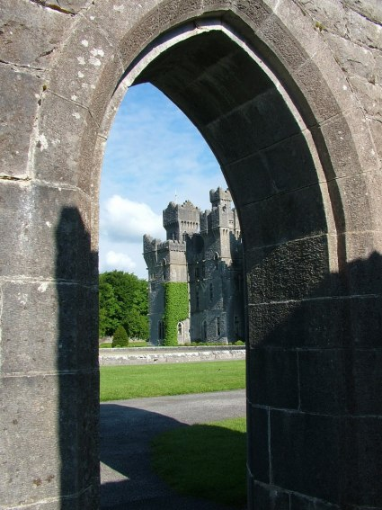 An image of Ashford Castle through a stone doorway in County Mayo, Ireland. Photography by Frame To Frame - Bob and Jean.
