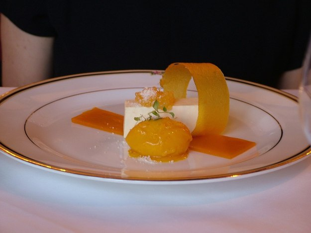 An image of Coconut Pate with Passion Fruit Caviar, Mango Sorbet and Gelee for dessert at Ashford Castle in County Mayo in Ireland. Photography by Frame To Frame - Bob and Jean.