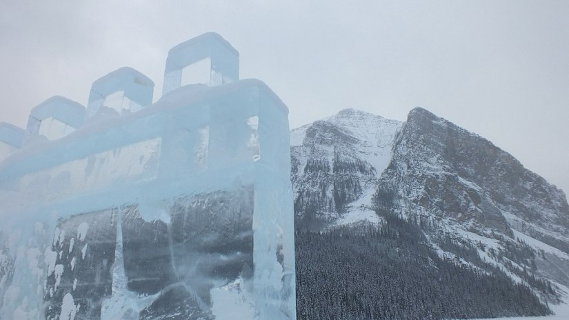 Ice Castle walls and snowy mountains at Lake Louise in Banff National Park, Alberta, Canada