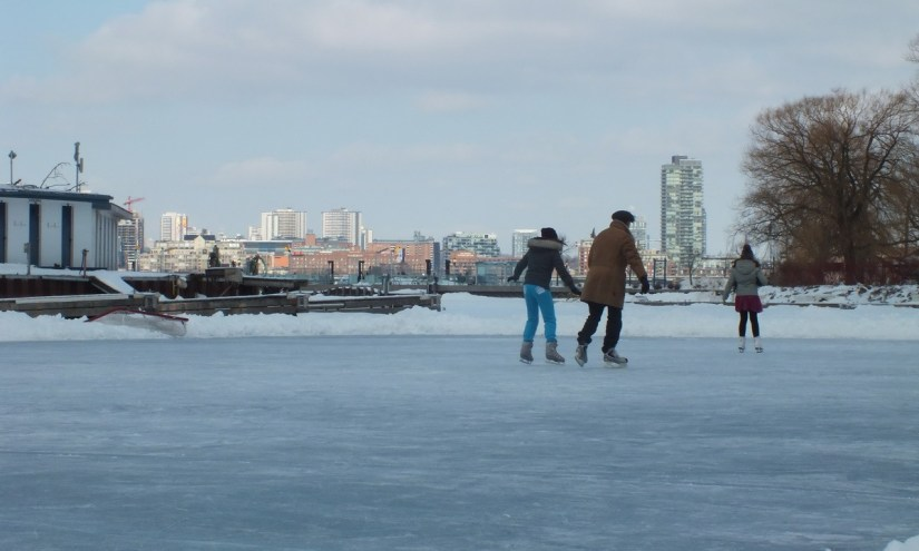 kids skate on lagoon skating rink on ward's island - toronto