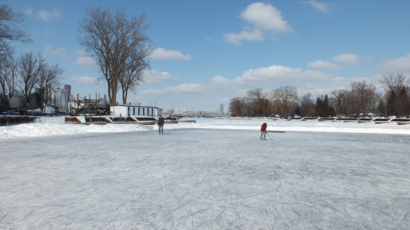 skaters on lagoon skating rink on ward's island - toronto