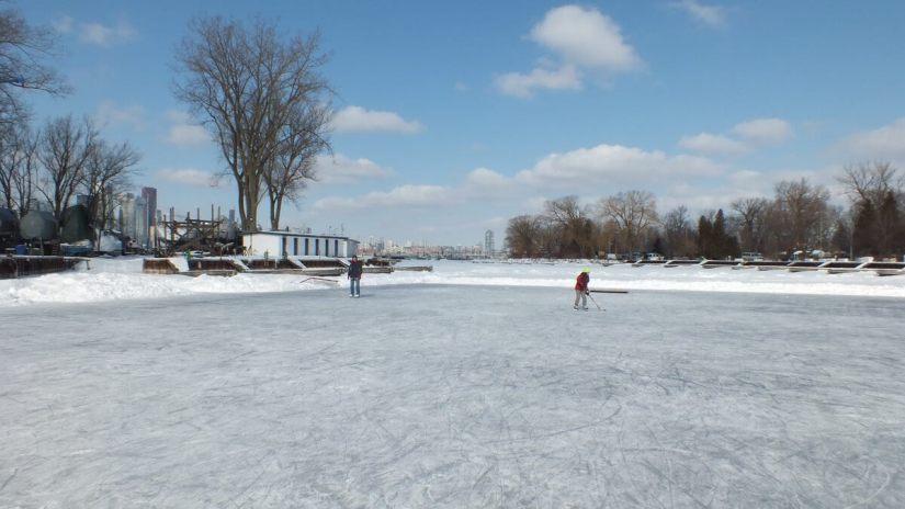 skaters on lagoon skating rink on ward's island - toronto