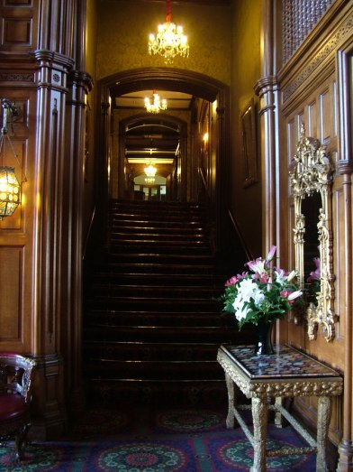 An image of a staircase inside Ashford Castle in County Mayo in Ireland. Photography by Frame To Frame - Bob and Jean.