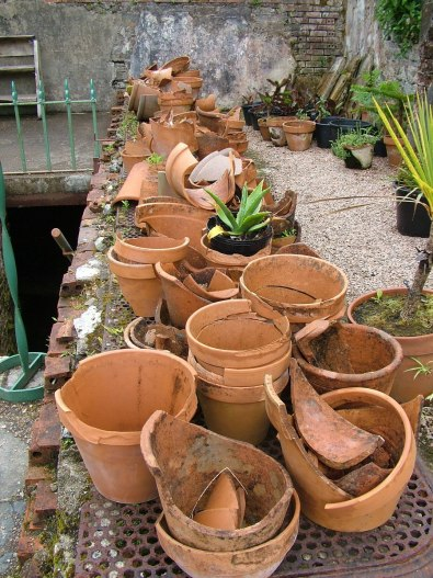 Broken flower pots and a stone wall in the Walled Victorian Gardens at Kylemore Abbey in County Galway, Ireland.
