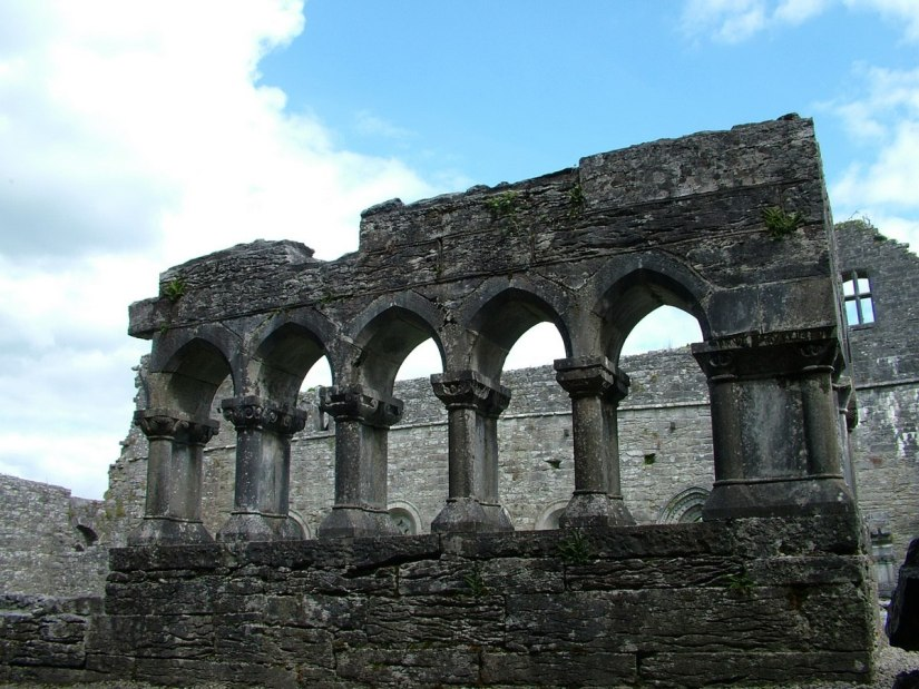 An image of the ruins of a stone colonnade at the Royal Abbey of Cong in Cong, County Mayo, Ireland. Photography by Frame To Frame - bob and jean