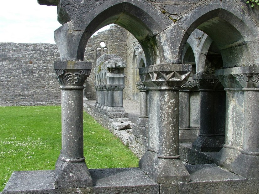 An image of the stone cloisters among the ruins of the Royal Abbey of Cong in Cong, County Mayo, Ireland. Photography by Frame To Frame - Bob and Jean.