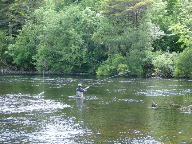 An image of a fly fisherman fishing on the Cong Canal near the Royal Abbey of Cong, in Cong, Ireland. Photography by Frame To Frame - Bob and Jean.