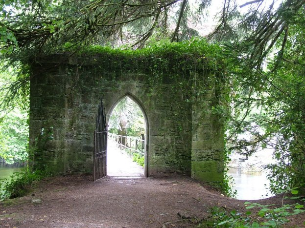 An image of the stone entrance gate to the stone bridge over the Cong Canal at the Royal Abbey of Cong in Cong, County Mayo, Ireland. Photography by Frame To Frame - Bob and Jean