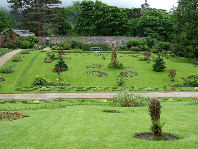 An image of a flower garden in the Victorian Walled Garden at Kylemore Abbey in County Galway, Ireland. Photography by Frame To Frame - Bob and Jean.