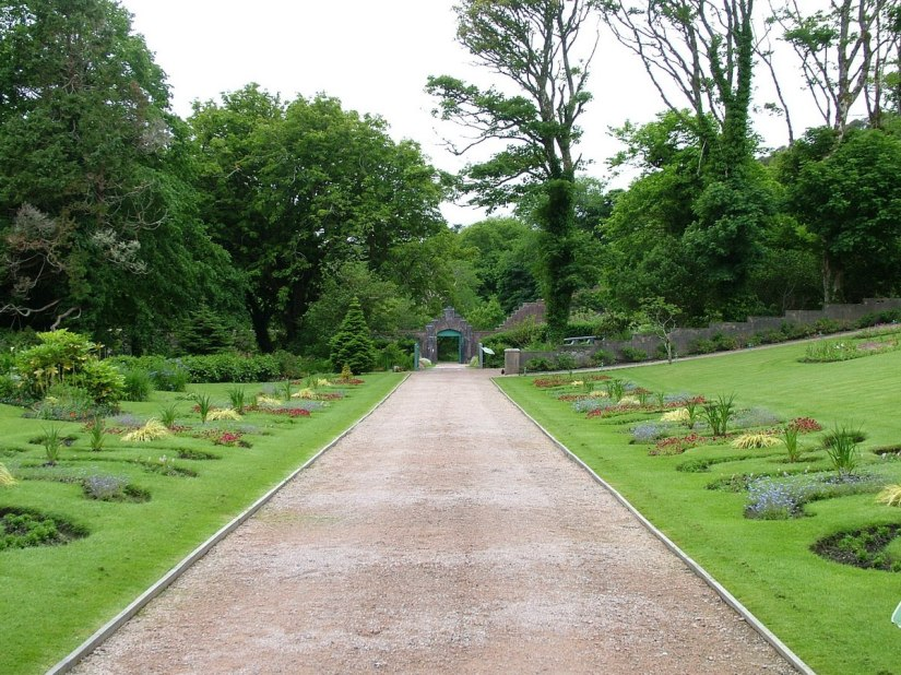 An image of the main walkway through the Victorian Walled Garden at Kylemore Abbey in County Galway, Ireland. Photography by Frame To Frame - Bob and Jean.