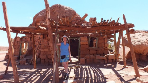 Jean standing in front of a Blanche Russell Rock House in Marble Canyon in Arizona, U.S.A.