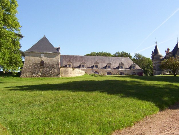 An image of front Lawn and buildings at Chateau de la Bourdaisiere in the Loire Valley, France.