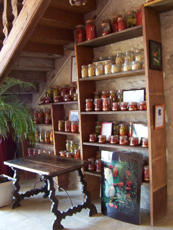 An image of jarred tomatoes on shelves at Chateau de la Bourdaisiere in the Loire Valley, France.