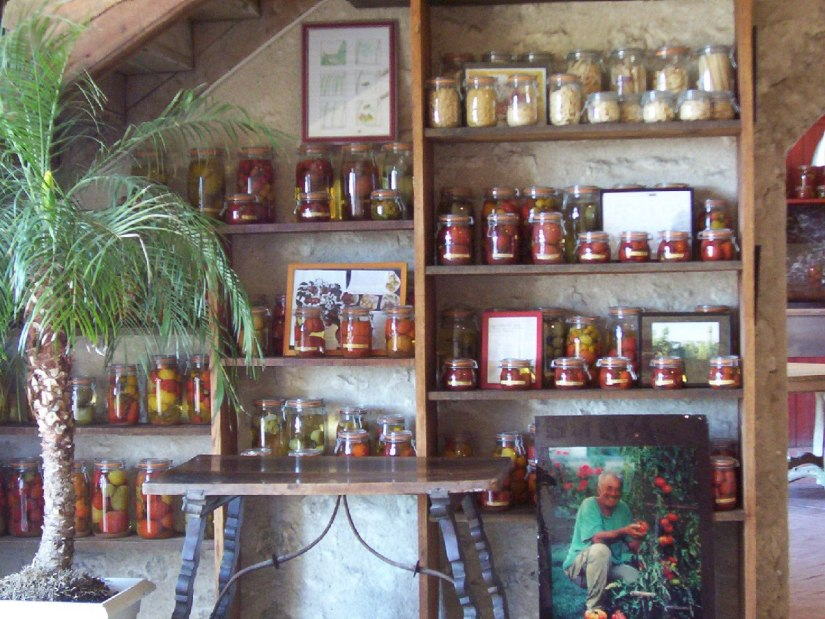 An image of jarred tomatoes in a showroom at Chateau de la Bourdaisiere in the Loire Valley, France.