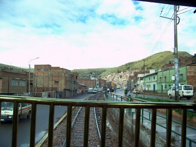 Peru Rail Andean Explorer going through Puno in Peru, South America